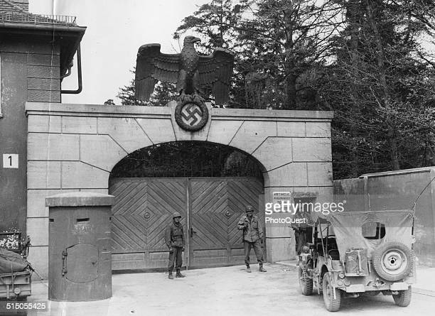 The main entrance to the Dachau Concentration Camp Dachau Germany 1945 Thousands of prisoners entered these doors and never came out alive American...