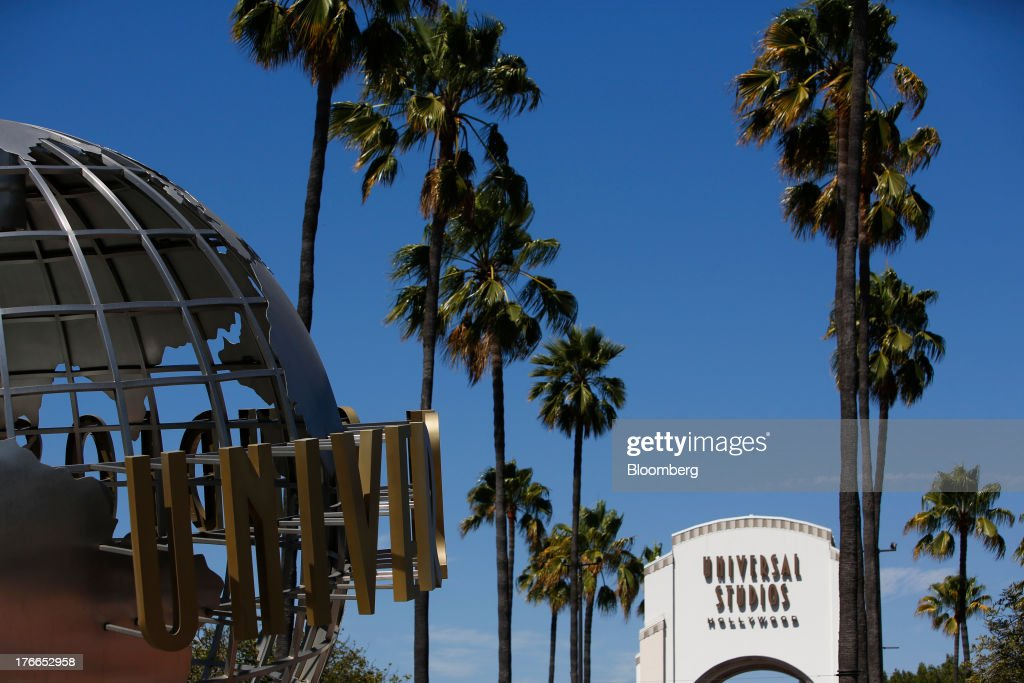 The main entrance to the Universal Studios Hollywood theme park stands in Hollywood, California, U.S., on Thursday, Aug. 15, 2013. NBC Universal, majority owned by Comcast Corp., operates some of the most-watched U.S. cable TV channels, in addition to its flagship broadcast network, a film studio and the Universal Studios amusement parks. Photographer: Patrick T. Fallon/Bloomberg via Getty Images