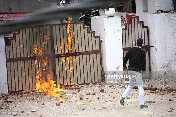 The main gate of Rohtak range IGPs office set on fire by protesting Jat students on February 19 2016 in Rohtak India They blocked several squares of...