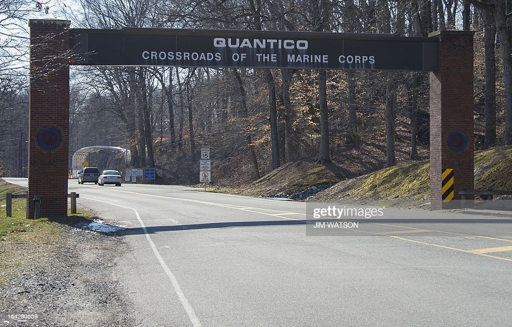 The main gate of the US Marine Corps Base in Quantico, Virginia, on March 22, 2013. A US Marine shot and killed two colleagues late March 21, 2013 before apparently turning the gun on himself at the base, the US Defense Department said on March 22. The suspected shooter and the victims were Marines who worked at an officer candidate school at the base, said base spokesman Sergeant Christopher Zahn. AFP PHOTO/Jim WATSON