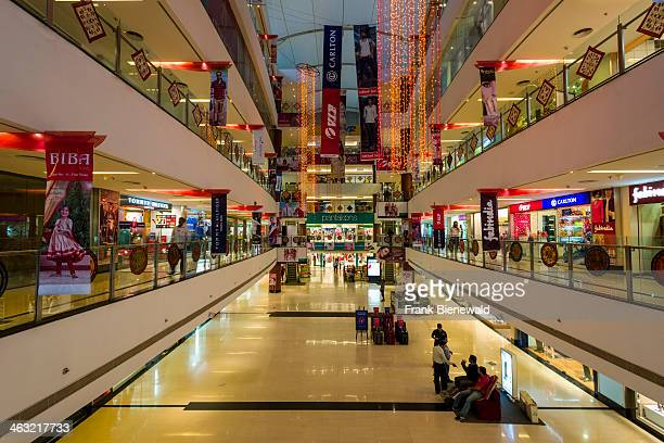 The main hall of the modern shopping mall Gulmohar Park with four floors and many shops