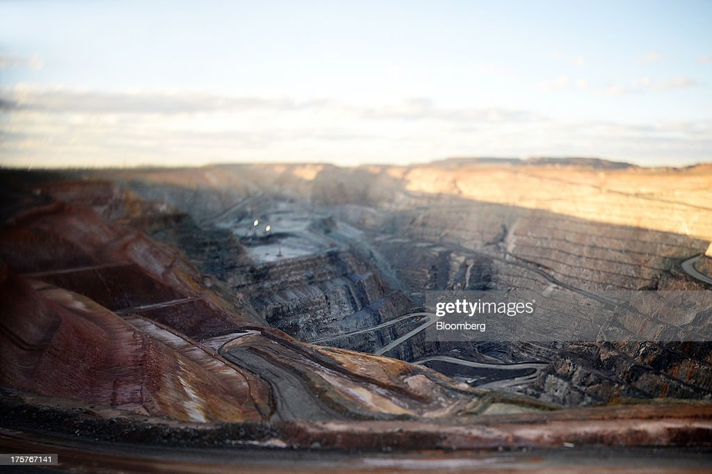 The main haul road winds through the Fimiston Open Pit, known as the Super Pit, in this photograph taken with a tilt-shift lens in Kalgoorlie, Australia, on Monday, Aug. 5, 2013. The Super Pit is managed by Kalgoorlie Consolidated Gold Mines Ltd., jointly owned by Barrick Gold Corp., the world's largest producer of the metal, and Newmont Mining Corp., the second-largest gold producer. Photographer: Carla Gottgens/Bloomberg via Getty Images