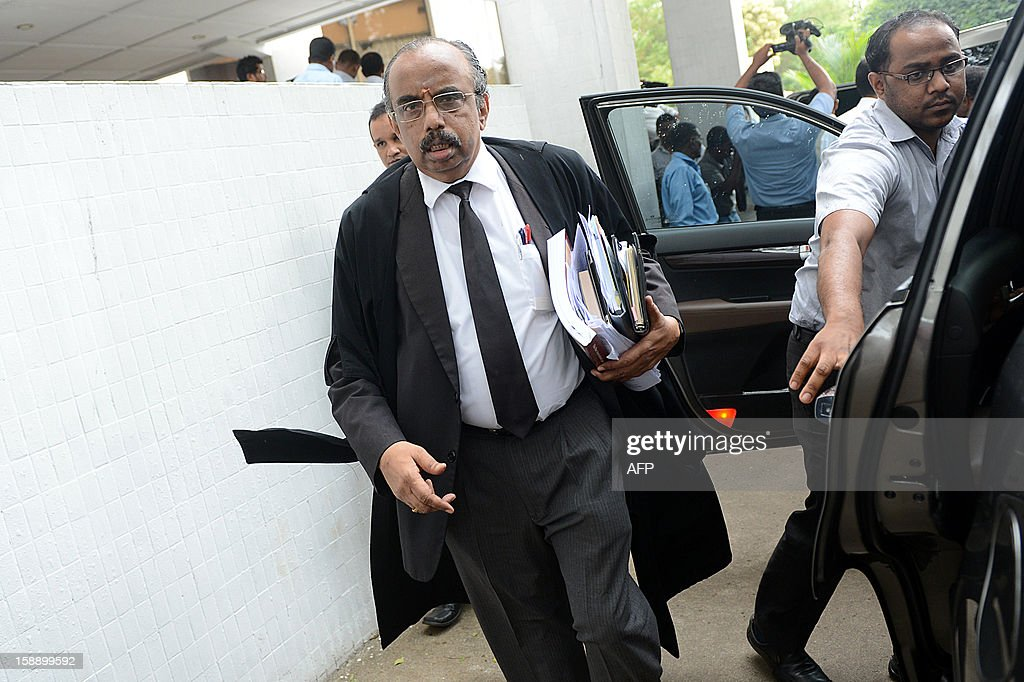 The main lawyer for the impeached Sri Lankan chief justice Shirani Bandaranayake Kandiah Neelakamdan (C) walks with his legal team at the Supreme Court Complex in Colombo on January 3, 2013, after a Supreme Court decision that virtually struck down a move by the ruling party to impeach the Chief Justice Shirani Bandaranayake. The Court held that parliament could not use its own standing orders to try the chief justice who faces allegations of misconduct from the ruling party after she struck down several bills of the government. AFP PHOTO/ Ishara S