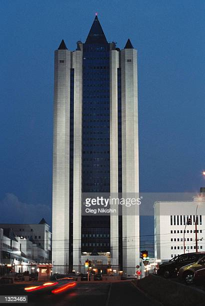 The main office of the Russian natural gas monopoly Gazprom is illuminated at night July 7 2001 in Moscow Russia