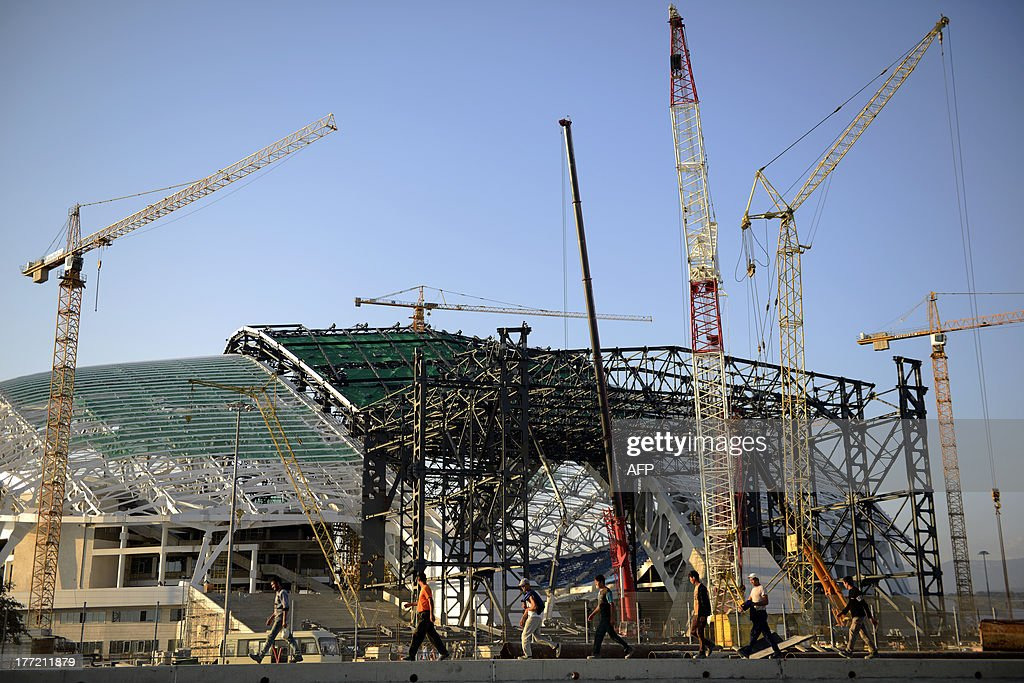 The main Olympic Stadium, the 'Fish,' is under construction at the Olympic Park in Adler, outside the Russian Black Sea resort of Sochi, on August 22, 2013. Sochi will host the 2014 Winter Olympics. AFP PHOTO / MIKHAIL MORDASOV
