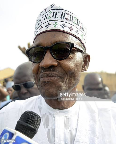 The main opposition All Progressives Congress presidential candidate Mohammadu Buhari speaks after registering to vote on March 28 2015 in Gidan...