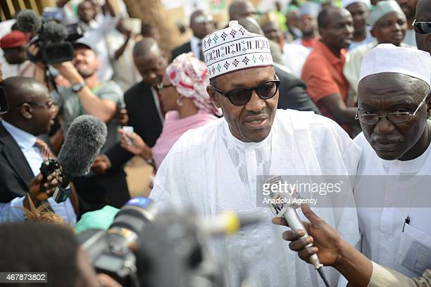 The main opposition All Progressives Congress presidential candidate Mohammadu Buhari speaks to the press as he arrives for registration at Gidan...