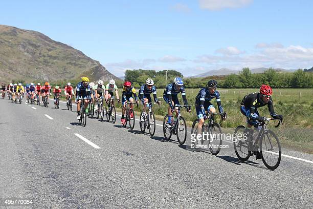 The main peloton heads towards Queenstown in stage four of the Tour of Southland on November 5 2015 in Invercargill New Zealand