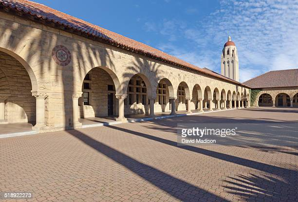 The Main Quadrangle of Stanford University in Palo Alto California USA was completed in 1906 is seen with shadows of palm trees cast on the buildings...