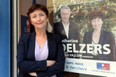 The main rightwing opposition UMP party candidate Catherine Delzers poses at her campaign headquarters in Brignoles on October 7 2013 a day after she...