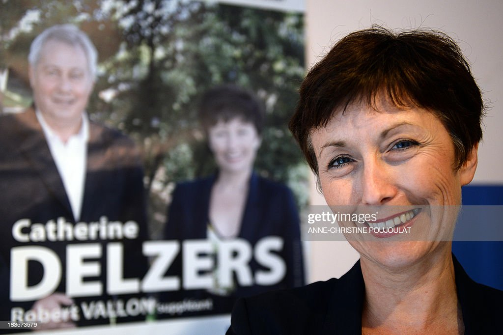 The main right-wing opposition UMP (Union for a Popular Movement) party candidate, Catherine Delzers, poses at her campaign headquarters in Brignoles on October 7, 2013 a day after she arrived second in the first round of a local by-election with 20.9% of votes. France's ruling Socialist Party expressed dismay Monday after two far right candidates came within a whisker of claiming 50 percent of the vote in a local by-election.