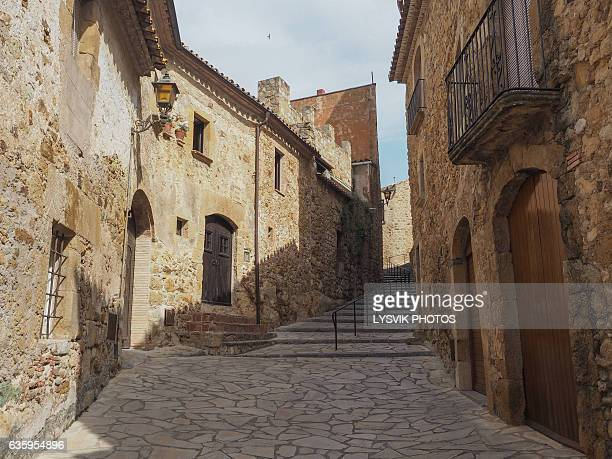 The main street of Pals, a medieval town in Catalonia