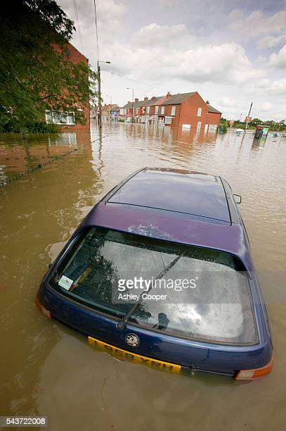 The main street of Toll Bar near Doncaster UK flooded in the June 2007 unprecedented summer floods | Location Toll Bar near Doncaster England UK
