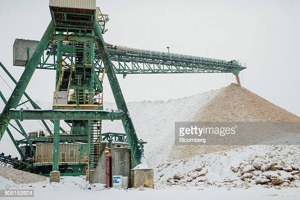 The main transfer conveyor moves newly delivered wood at the Resolute Forest Products mill in Thunder Bay Canada Ontario on Thursday Jan 7 2016...