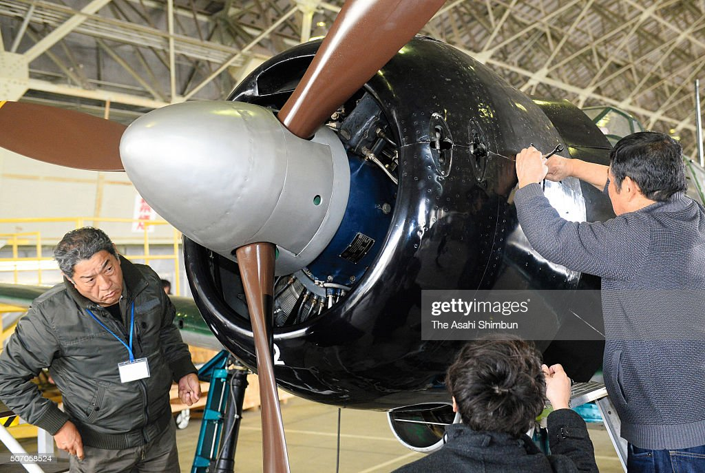 The maintenance work continues prior to the restored Mitsubishi Zero fighter test flight at the Japan Maritime SelfDefense Force Kanoya Airbase on...
