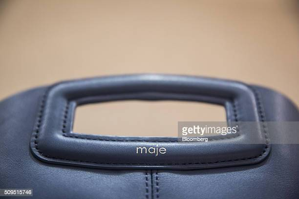 The Maje logo sits on a leather handbag inside a Maje luxury clothing store operated by SMCP Group in Toulouse France on Wednesday Feb 10 2016...