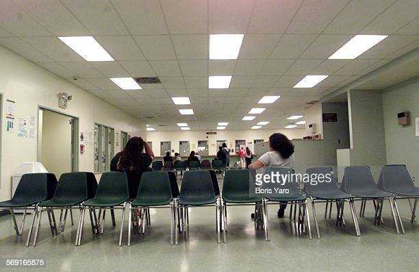 The majority of the seats in the waiting room of the LA County Welfare office in Van Nuys were empty even though some of the staff were outside...