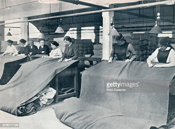 examining the finished cloth c1914 Khaki manufacture for soldiers uniforms during World War I From 'The Manchester Guardian History of the War' Vol...