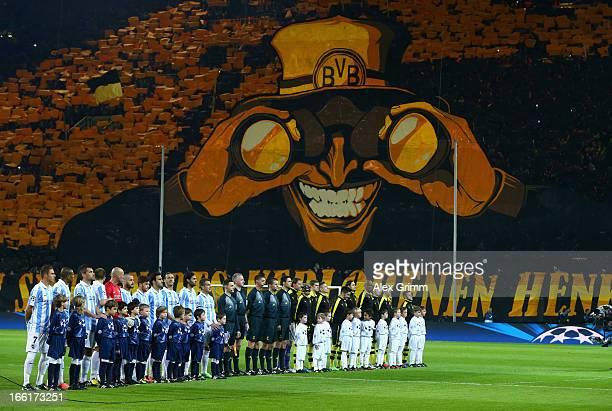 The Malaga and Borussia Dortmund teams line up ahead of the UEFA Champions League quarterfinal second leg match between Borussia Dortmund and Malaga...