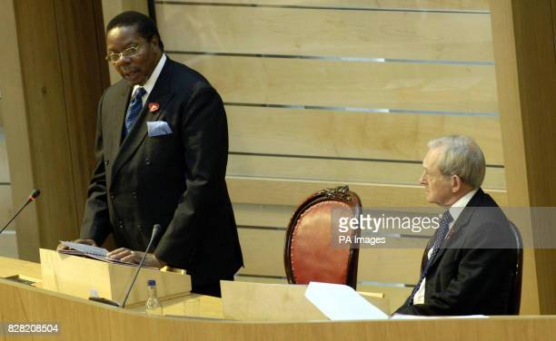 The Malawi president Dr Bingu wa Mutharika speaks while presiding officer George Reid watches in the Debating Chamber at the Scottish Paliament...