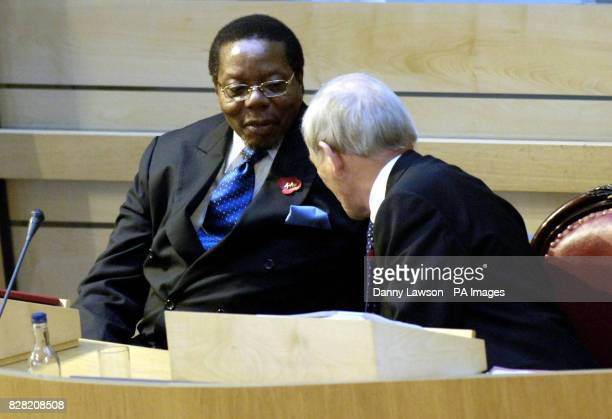 The Malawi president Dr Bingu wa Mutharika talks with presiding officer George Reid before delivering a speech in the Debating Chamber at the...
