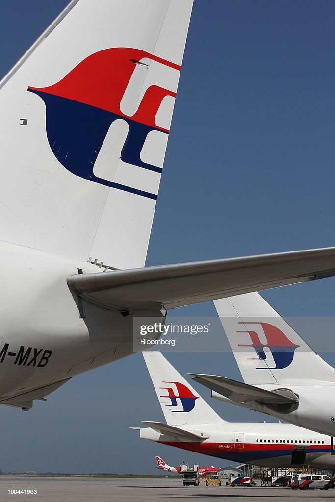 The Malaysian Airline System Bhd. (MAS) logo is displayed on the company's aircraft at Kuala Lumpur International Airport (KLIA) in Sepang, Malaysia, on Thursday, Jan. 31, 2013. Malaysia Airlines joins the Oneworld airline alliance tomorrow. Photographer: Goh Seng Chong/Bloomberg via Getty Images