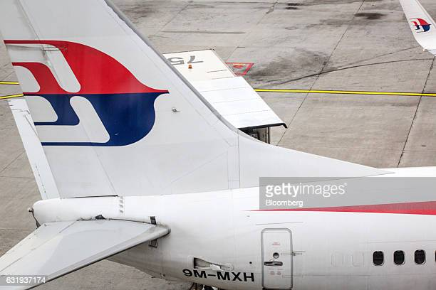 The Malaysian Airlines Bhd logo is seen on the tail fin of an aircraft at Kuala Lumpur International Airport in Sepang Selangor Malaysia on Tuesday...