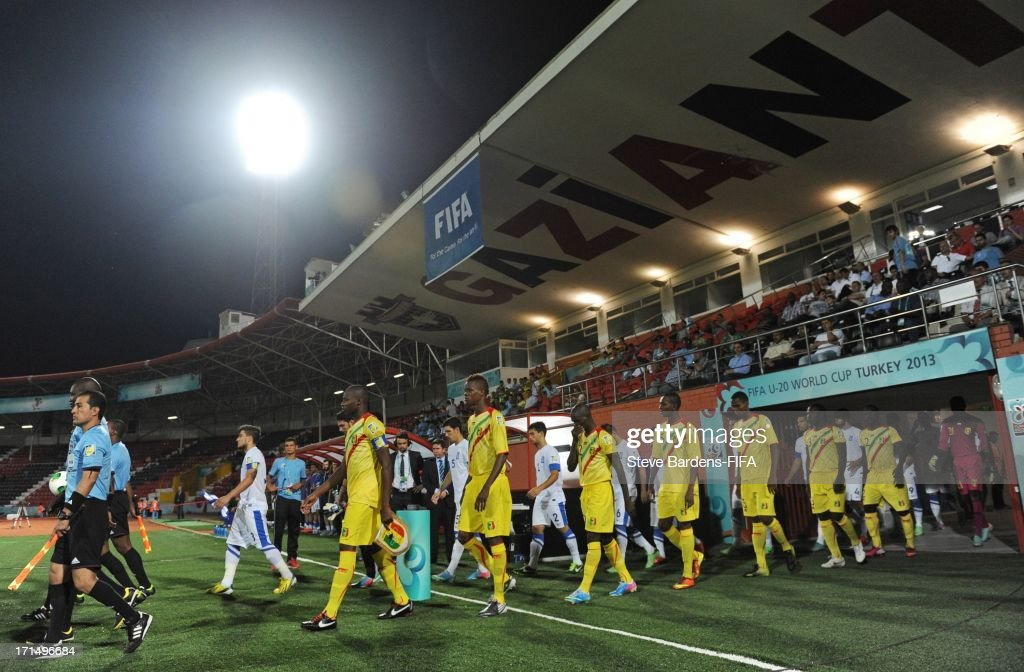 The Mali and Greece players walk onto the pitch before the FIFA U20 World Cup Group D match between Mali and Greece at Kamil Ocak Stadium on June 25, 2013 in Gaziantep, Turkey.
