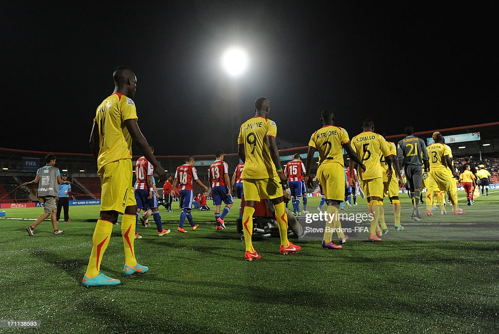 The Mali and Paraguay players walk onto the pitch before the FIFA U20 World Cup Group D match between Paraguay and Mali at Kamil Ocak Stadium on June 22, 2013 in Gaziantep, Turkey.
