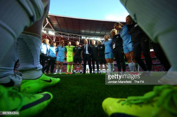 The Man City Ladies team and staff create a huddle to celebrate winning the cup after the SSE Women's FA Cup Final between Birmingham City Ladies and...
