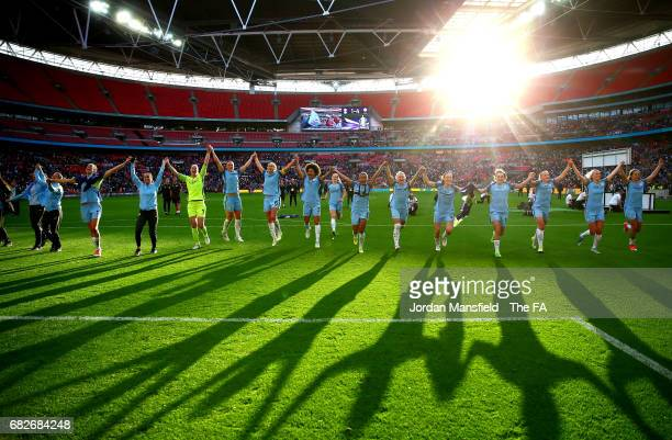 The Man City Ladies team celebrate winning the cup after the SSE Women's FA Cup Final between Birmingham City Ladies and Manchester City Women at...