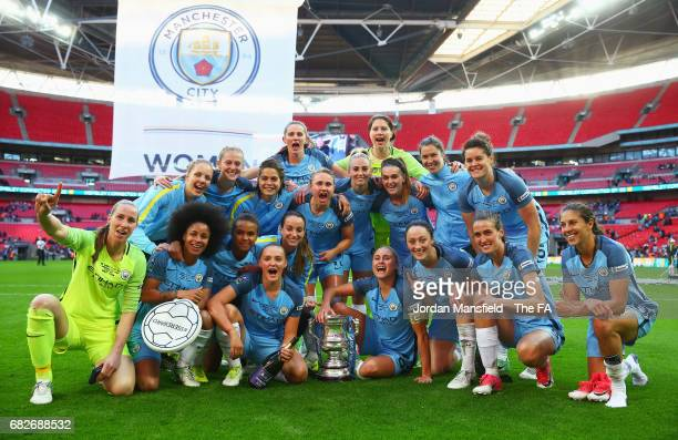 The Man City Ladies team pose for a photo with the trophy after they won the SSE Women's FA Cup Final between Birmingham City Ladies and Manchester...