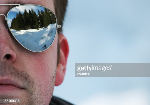 The Man in Mirrored Sunglasses