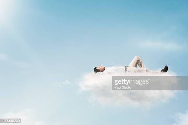 The man is relaxing in the clouds