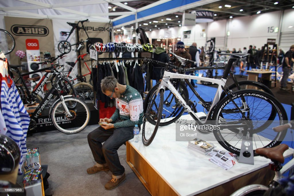 The man uses his phone on a stand at the London Bike Show which is being held in the ExCeL Centre on January 17, 2013 in London, England. The ExCeL centre is hosting The Outdoors Show, the London Bike Show and the Active Travel Show which run until January 20, 2013 and features manufacturer trade stalls, speeches, demonstrations and areas where visitors can climb or ride bikes.