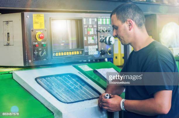 The man working on cnc milling machine