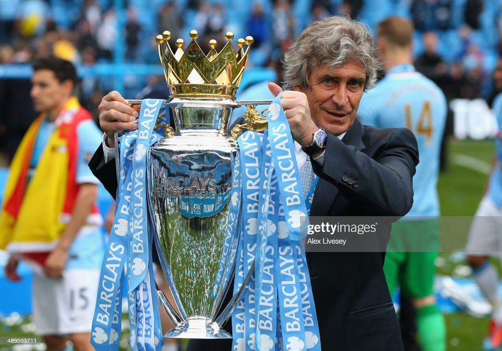 The Manchester City Manager <a gi-track='captionPersonalityLinkClicked' href=/galleries/search?phrase=Manuel+Pellegrini&family=editorial&specificpeople=673553 ng-click='$event.stopPropagation()'>Manuel Pellegrini</a> poses with the Premier League trophy at the end of the Barclays Premier League match between Manchester City and West Ham United at the Etihad Stadium on May 11, 2014 in Manchester, England.