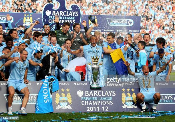 The Manchester City players celebrate with the trophy following the Barclays Premier League match between Manchester City and Queens Park Rangers at...