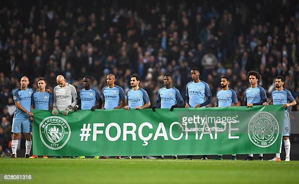 The Manchester City players observe a minutes silence for the victims of the plane crash involving the Brazilian club Chapecoense prior during the...