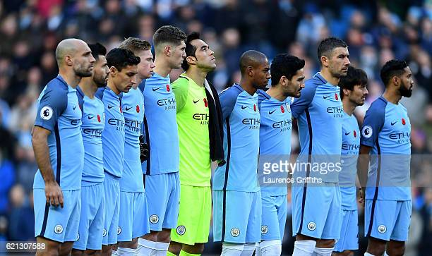 The Manchester City players take part in a mintues silence in honour of Remembrance Day prior to kick off during the Premier League match between...