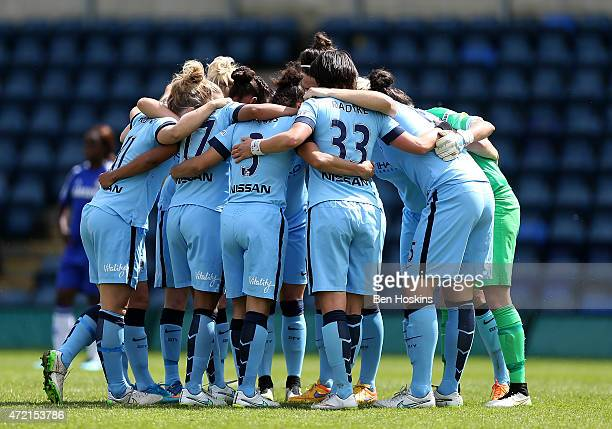The Manchester City team form a huddle during the Women's FA Cup Semi Final match between Chelsea Ladies and Manchester City Women at Adams Park on...