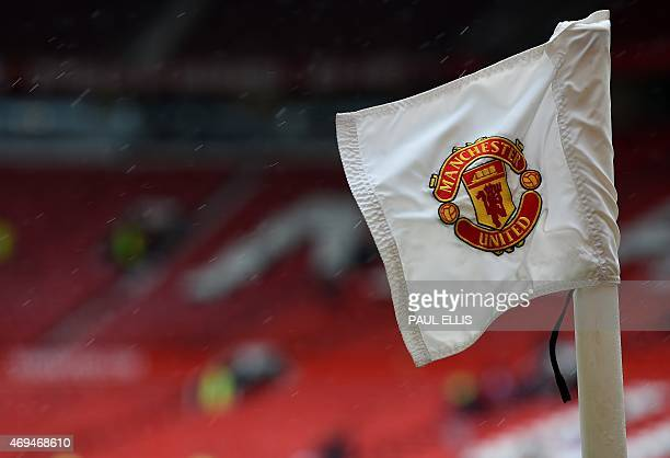 The Manchester United badge is seen on a corner flag ahead of the English Premier League football match between Manchester United and Manchester City...