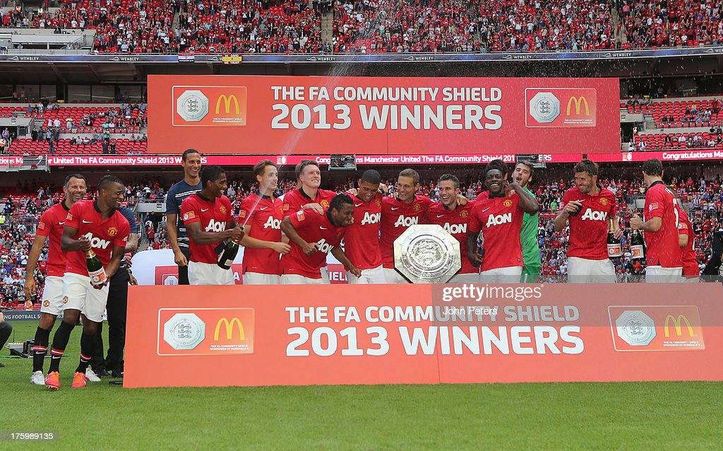 The Manchester United celebrates with the FA Community Shield trophy after the FA Community Shield match between Manchester United and Wigan Athletic at Wembley Stadium on August 11, 2013 in London, England.