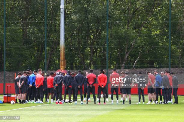 The Manchester United players and staff hold a minute silence in memory of the victims of the Manchester Concert attack during a Manchester United...