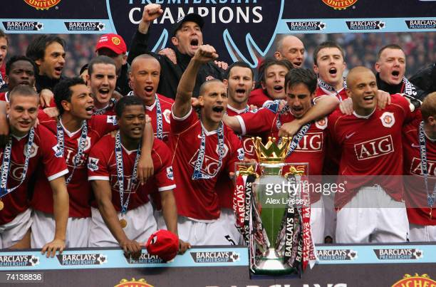 The Manchester United players celebrate winning the Premiership title with the trophy at the end of the Barclays Premiership match between Manchester...