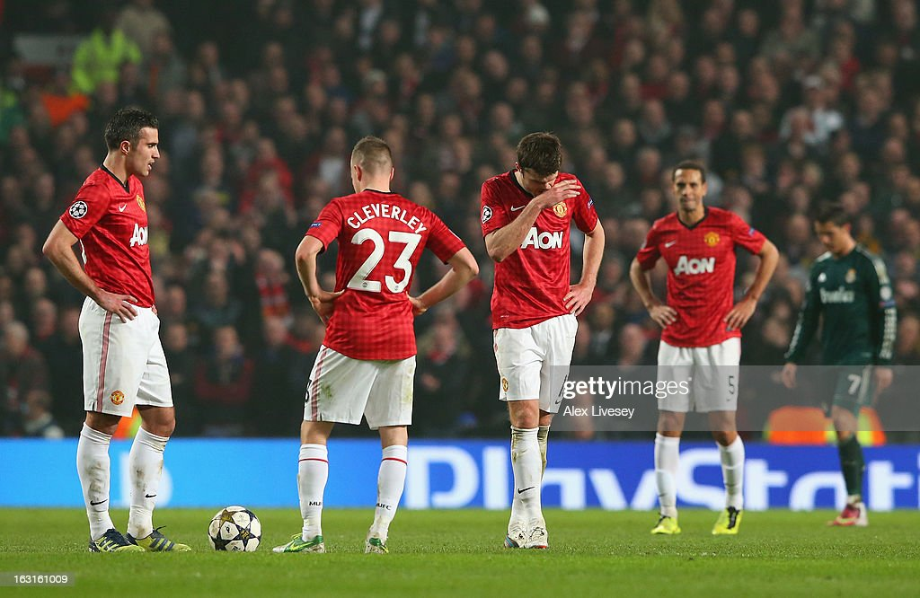 The Manchester United players look dejected after conceding a second goal during the UEFA Champions League Round of 16 Second leg match between Manchester United and Real Madrid at Old Trafford on March 5, 2013 in Manchester, United Kingdom.