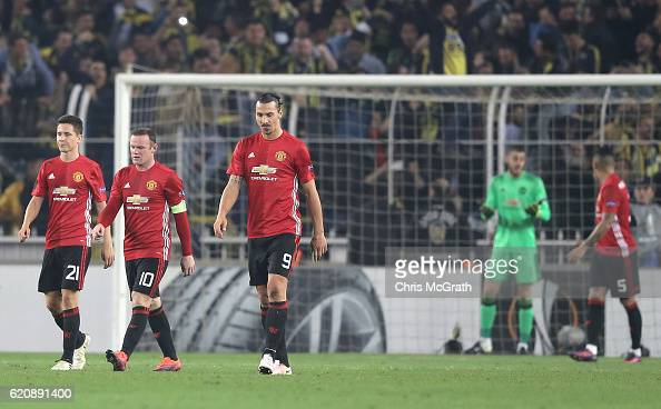 The Manchester United players make their wat back to the half way line after conceding their second goal during the UEFA Europa League Group A match...