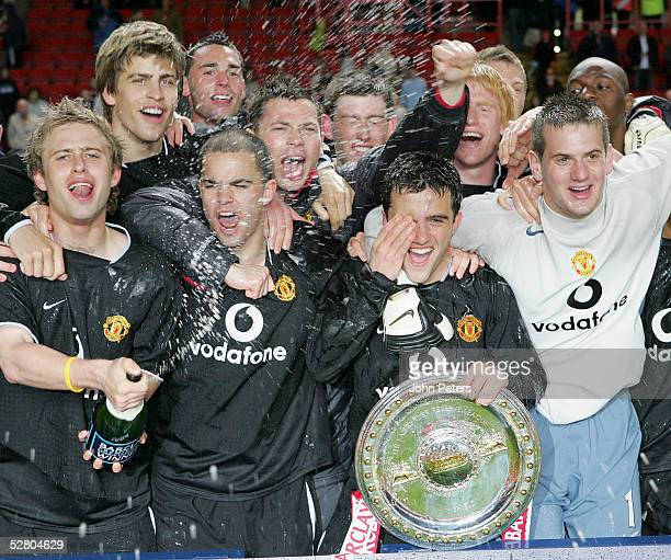 The Manchester United Reserve team celebrate with the trophy after winning the Barclays FA Premier Reserve League Shield playoff final match between...