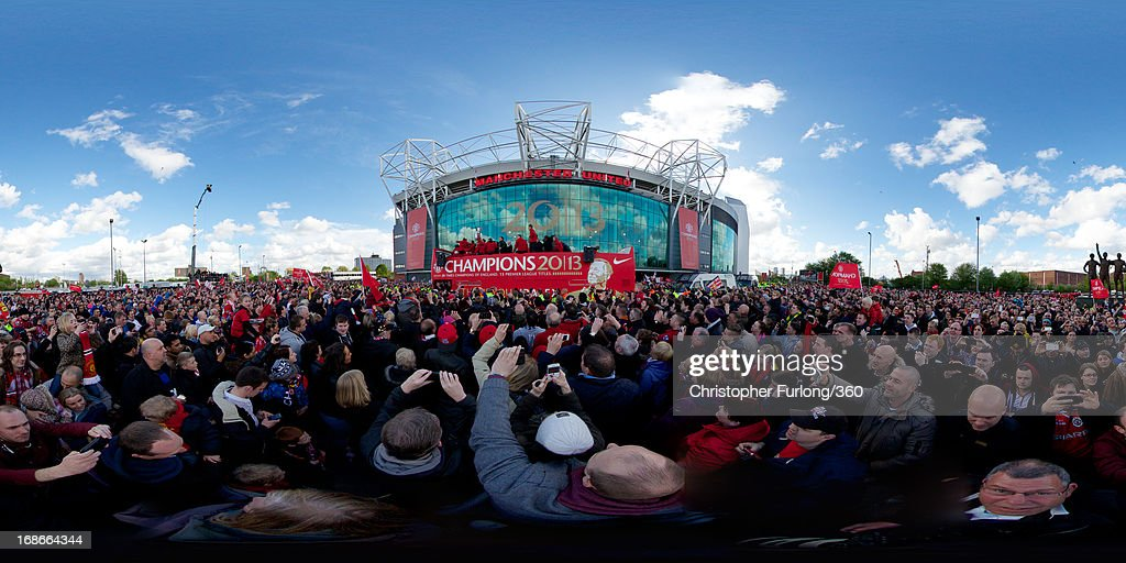 The Manchester United squad celebrate on an open-top bus at the start of their Barclays Premier League Trophy Parade through Manchester on May 13, 2013 in Manchester, England.