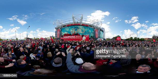 The Manchester United squad celebrate on an opentop bus at the start of their Barclays Premier League Trophy Parade through Manchester on May 13 2013...